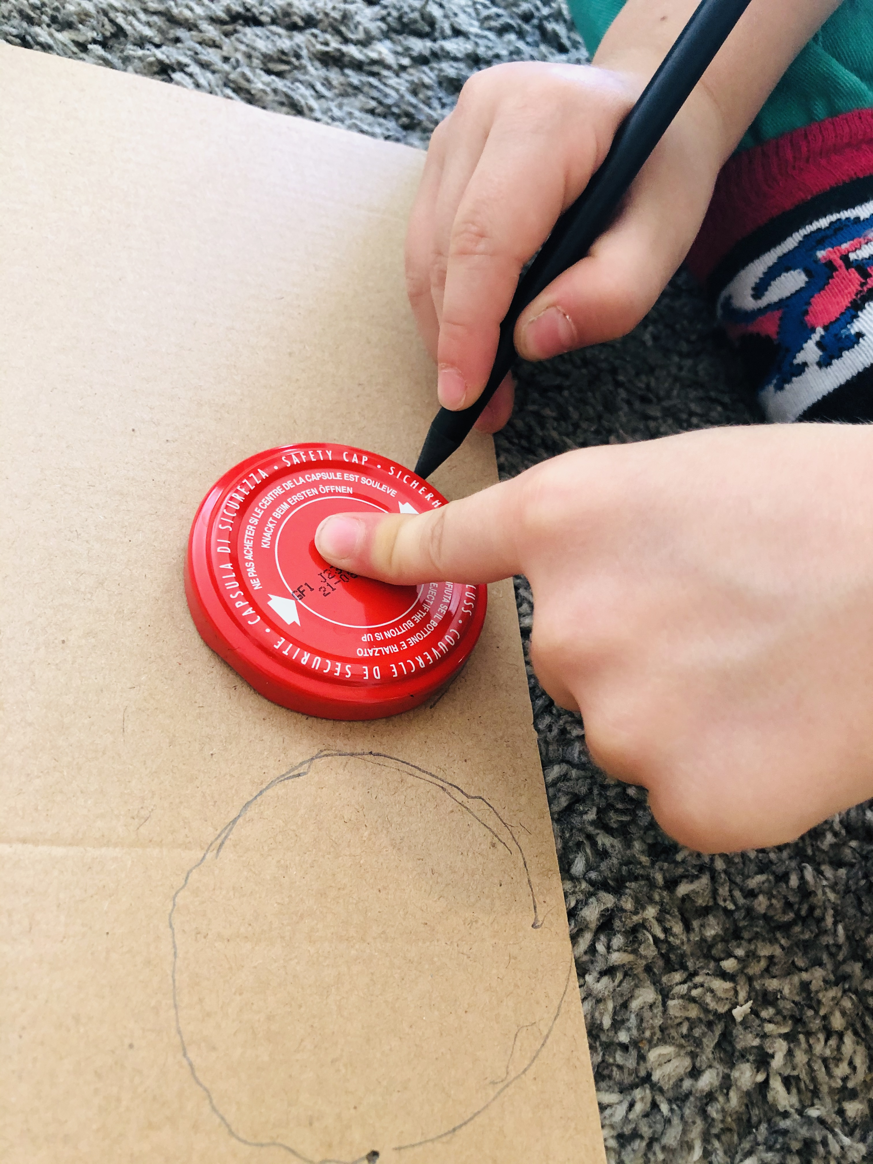 kid drawing a circle for a maze labyrinth