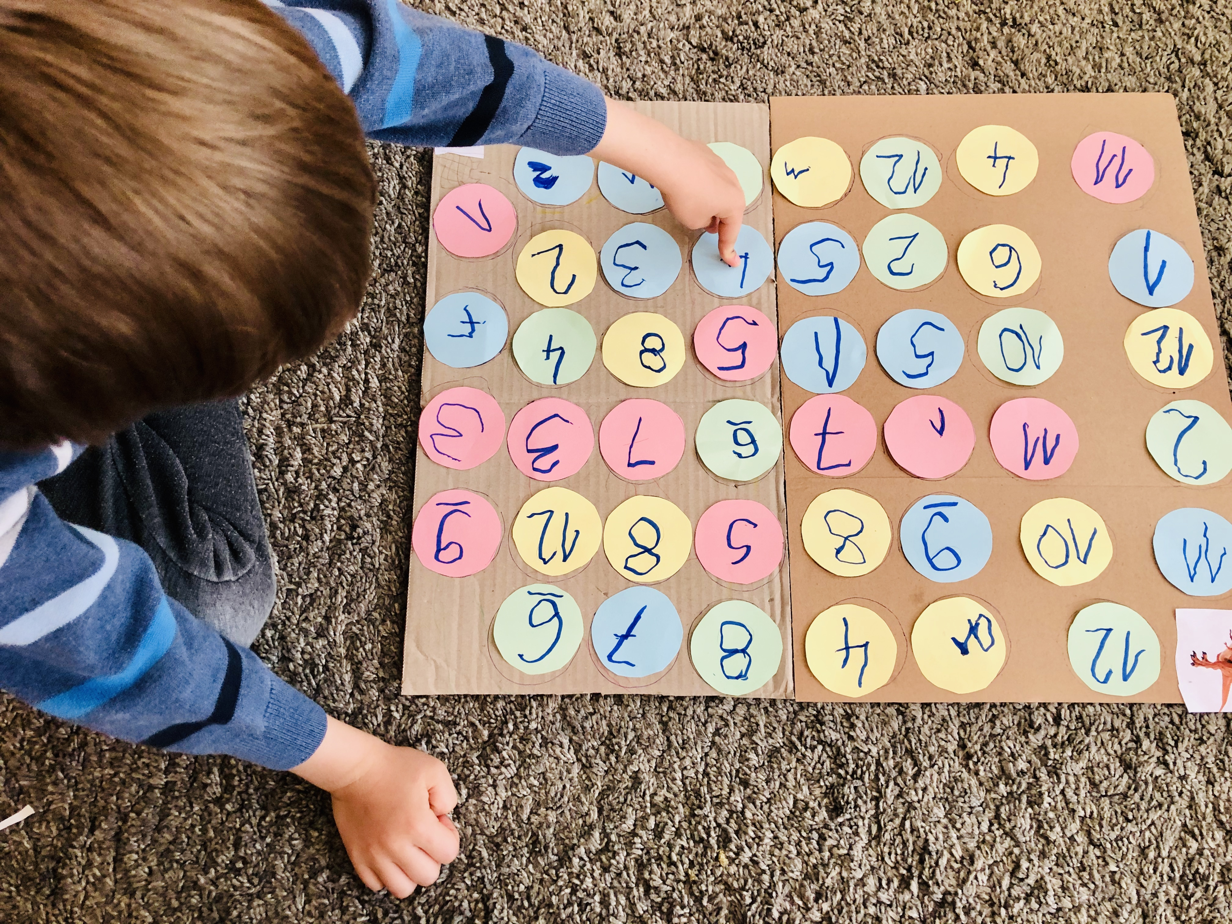 kid playing with numbers maze