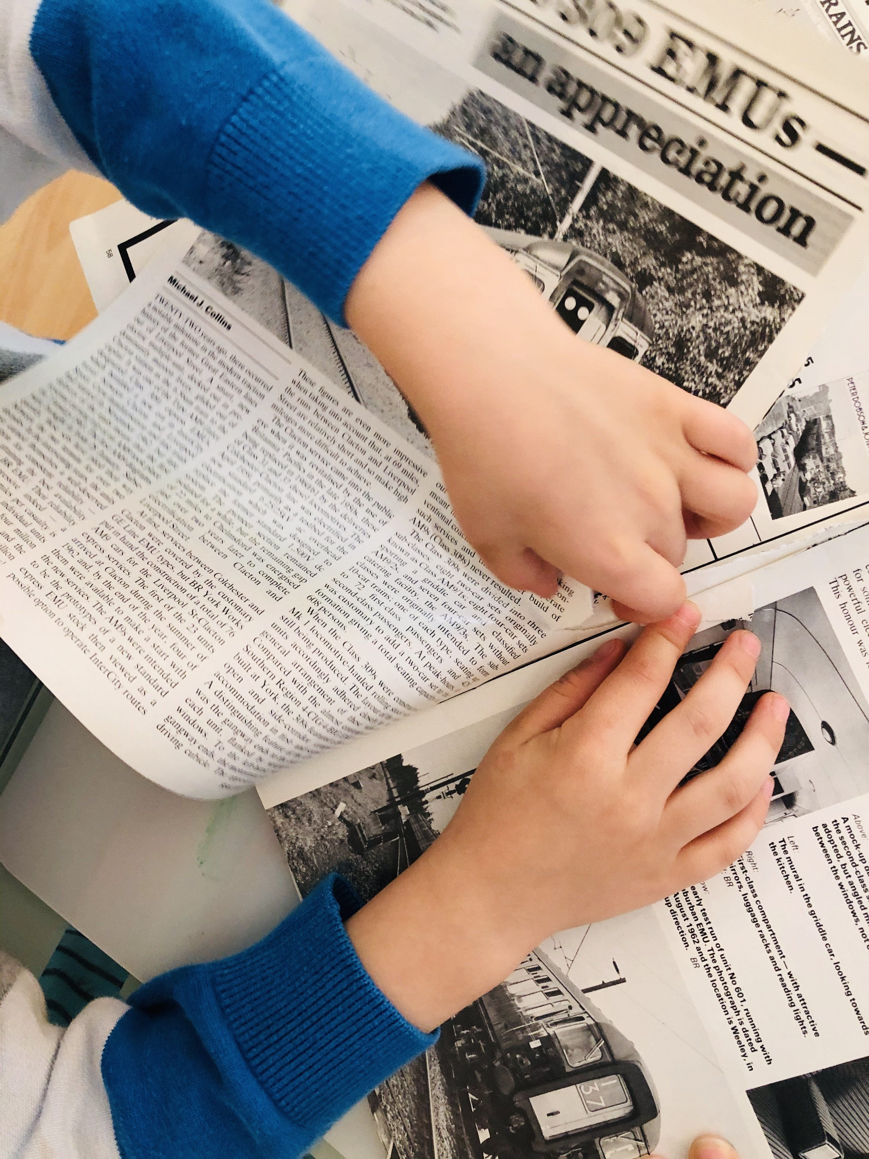 kid ripping pages out of an old magazine