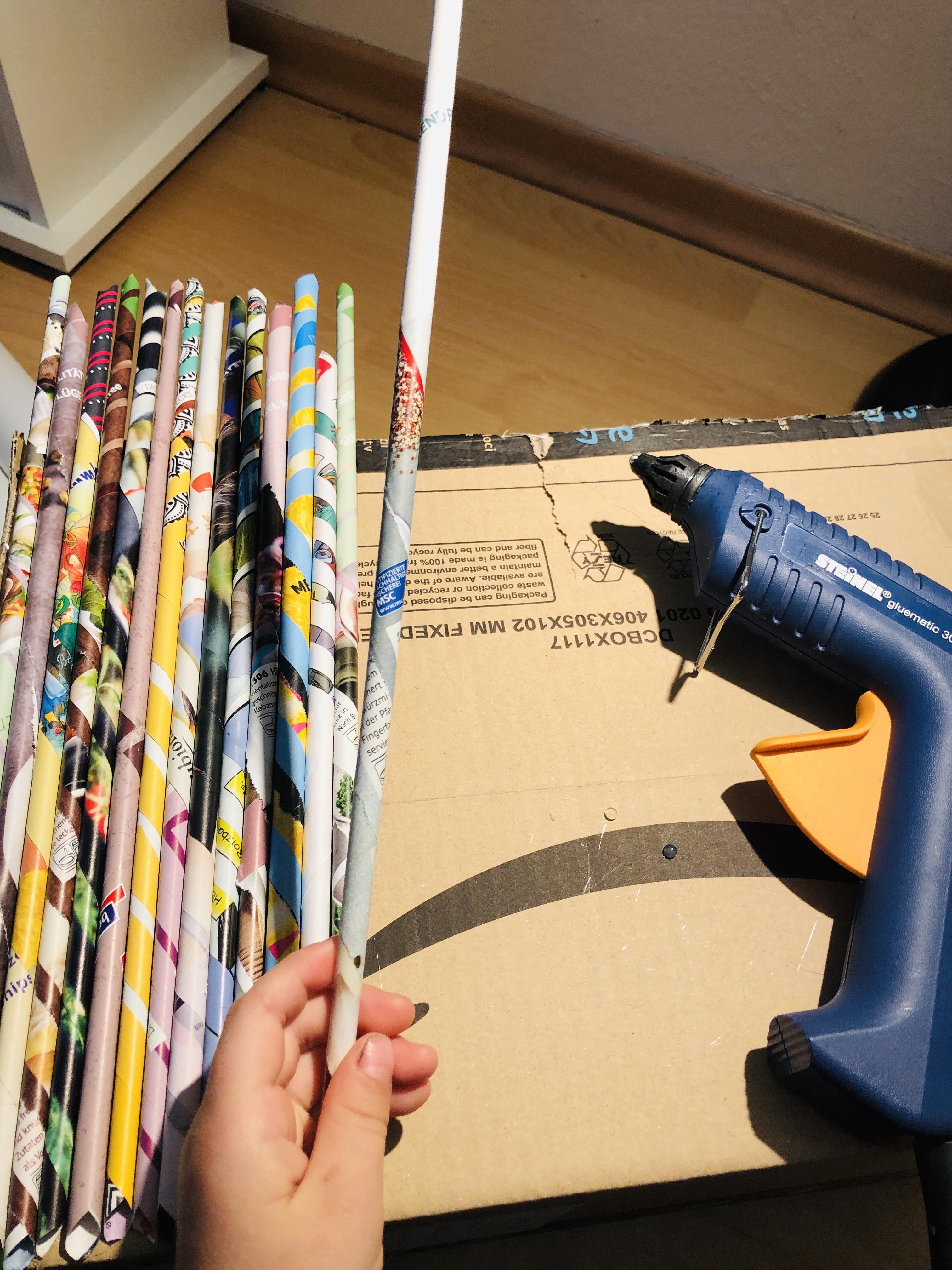 glueing paper rolls on a cardboard box