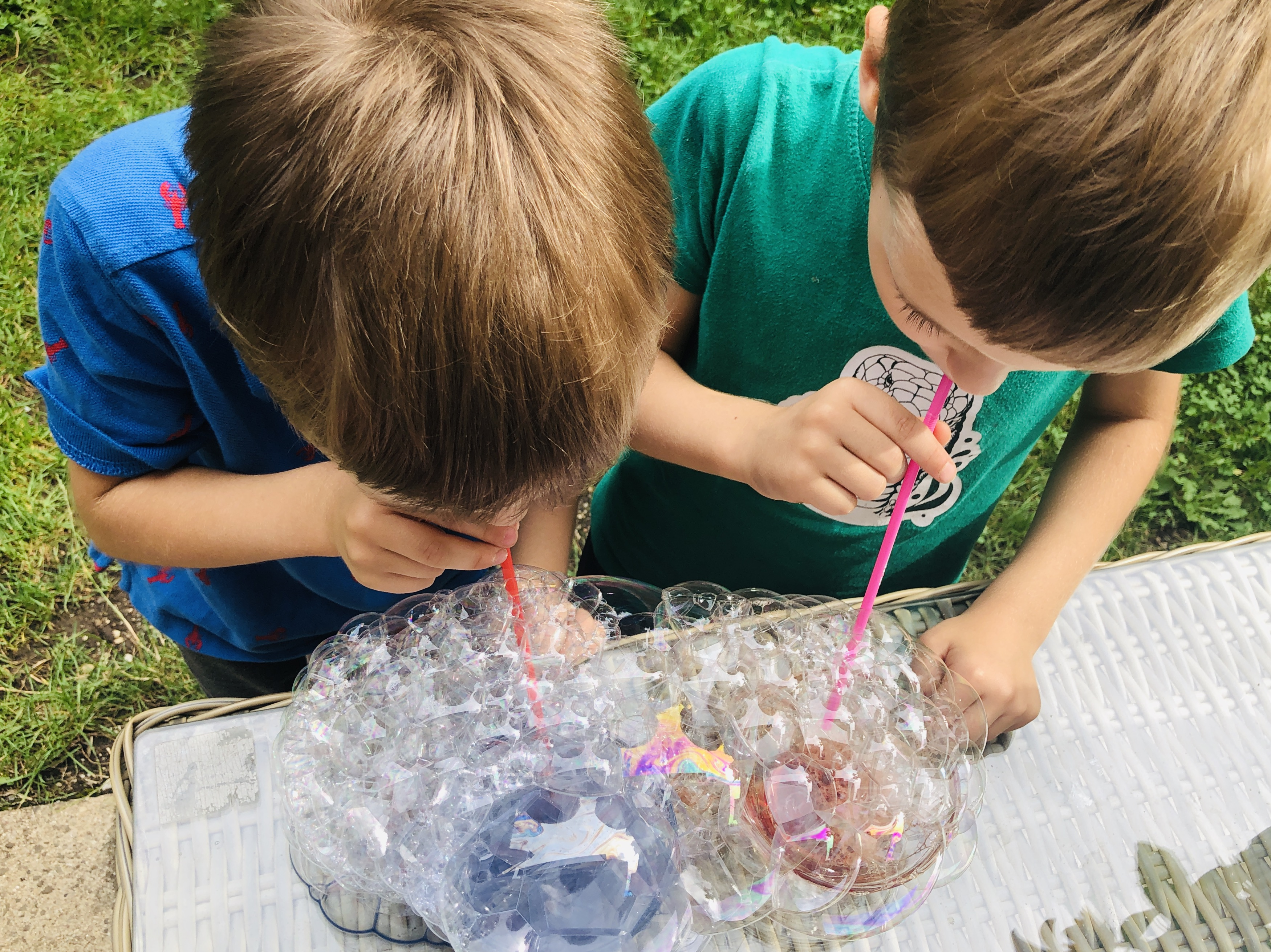 blowing bubbles with straws