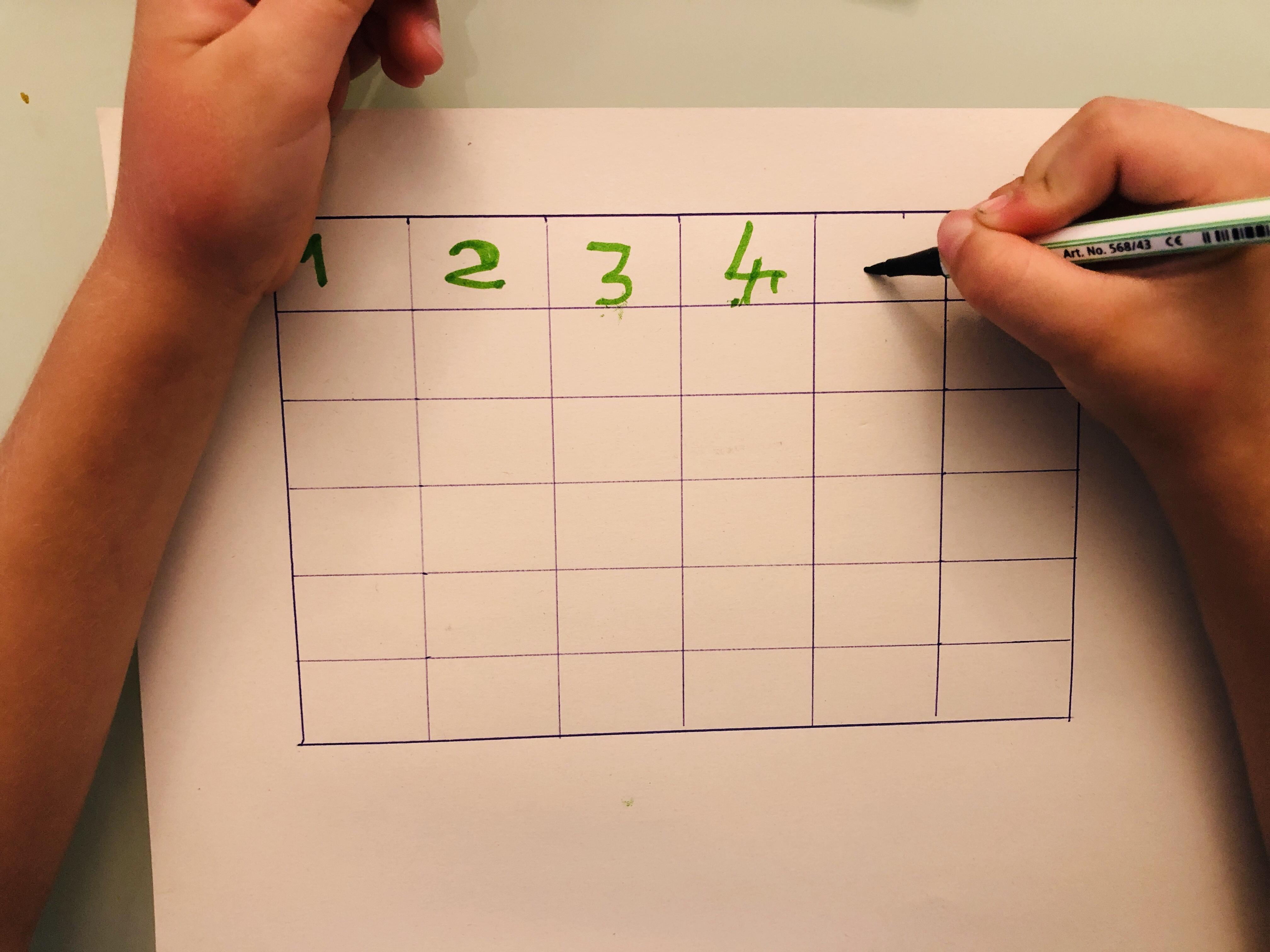 writing numbers on a dice bingo card