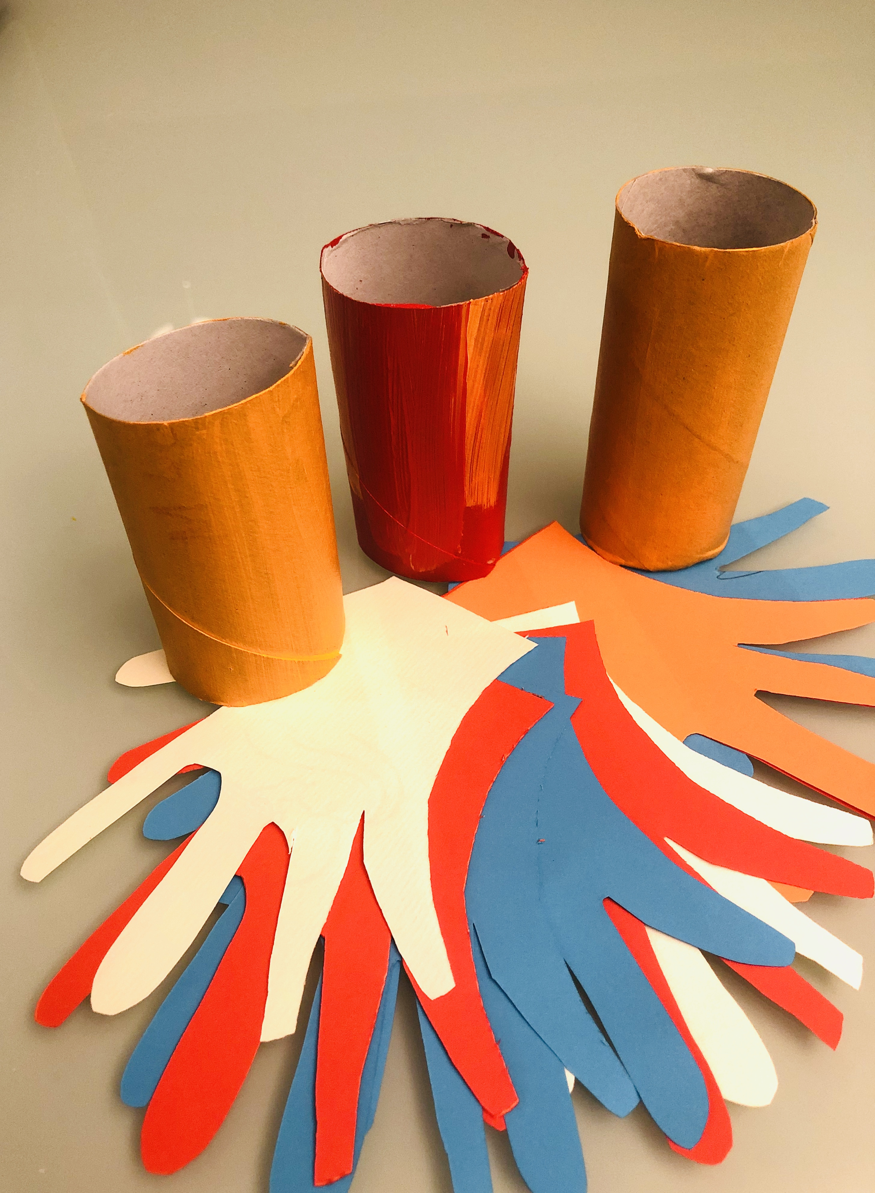 toilet paper rolls and hand cut-outs for the parrots