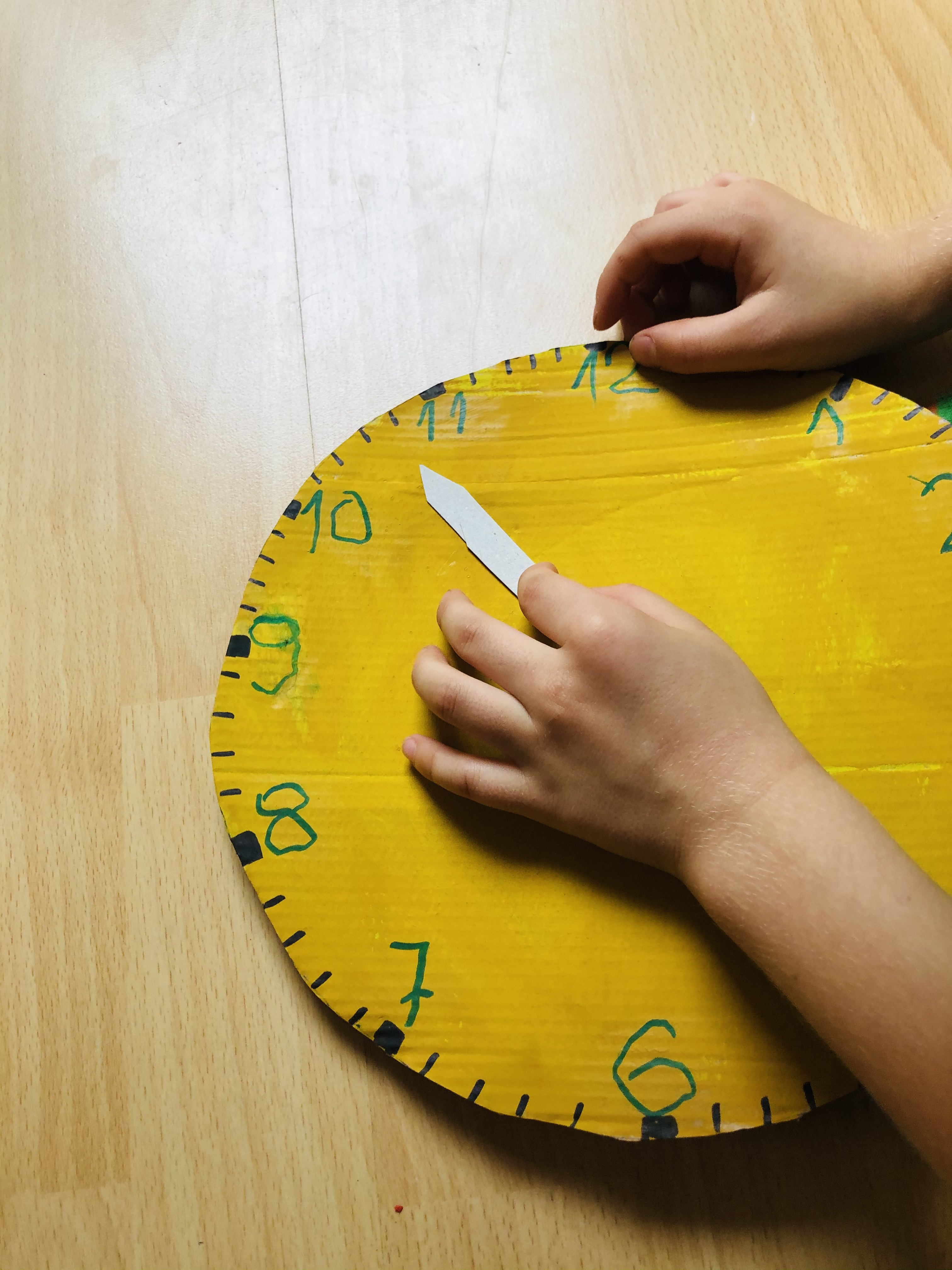 kid playing with a model clock
