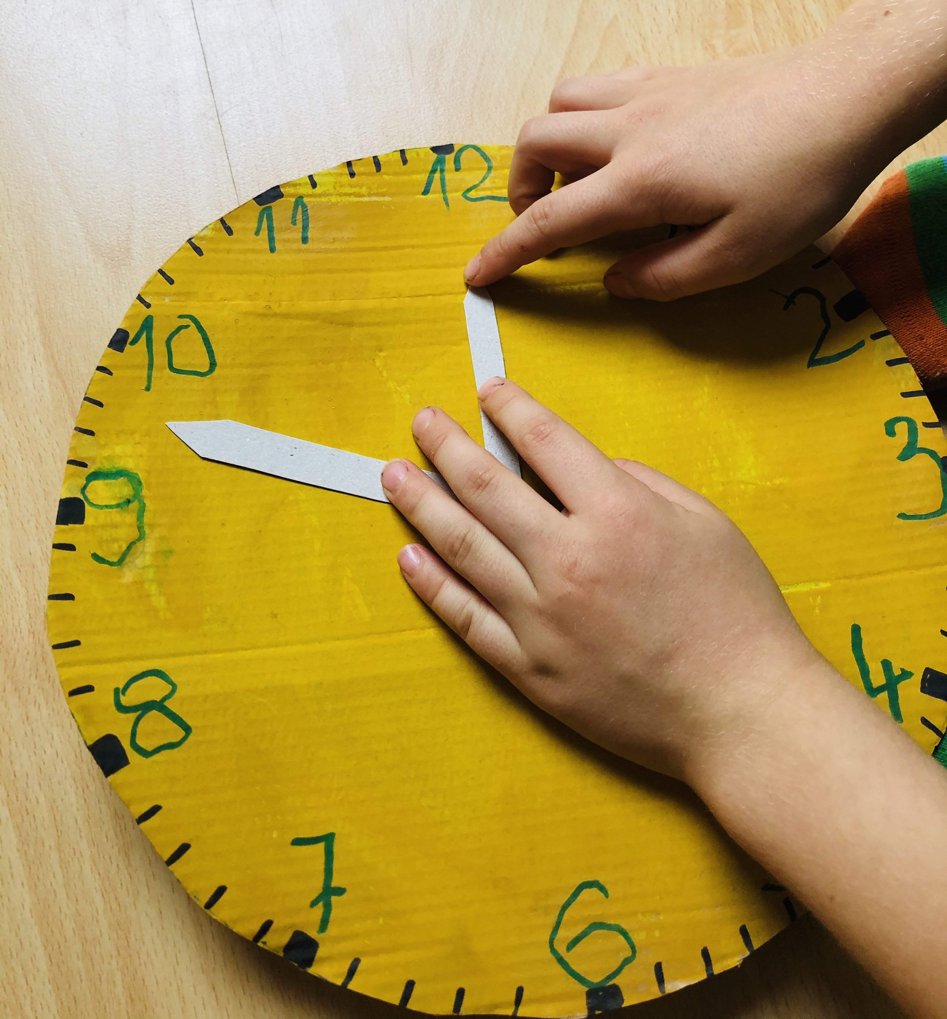 kid playing with a DIY clock