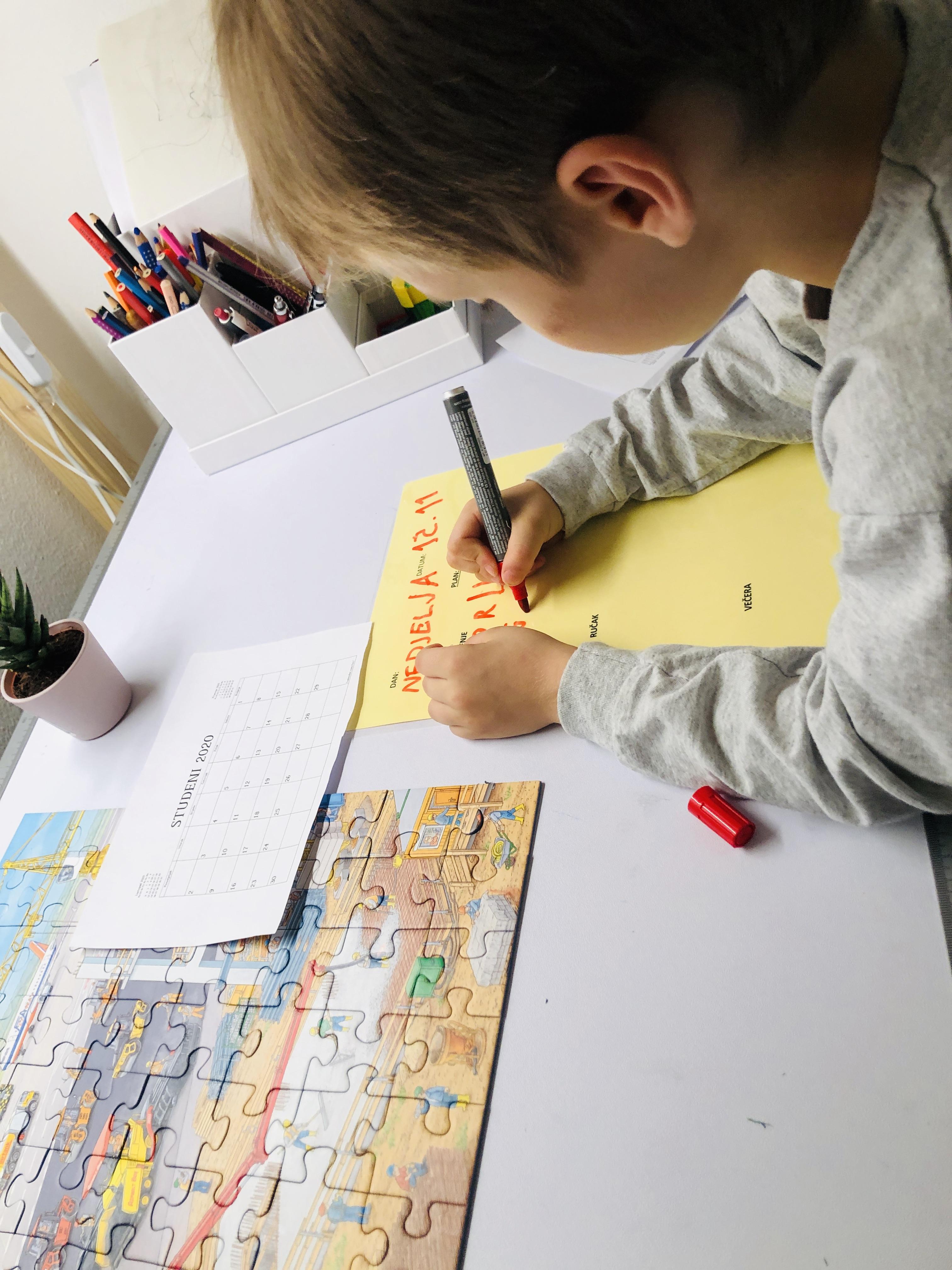 kid making his list of activities